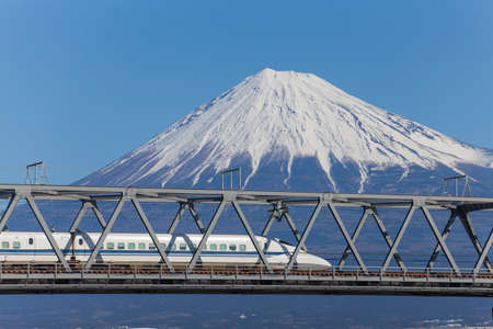 bullets: Bullet train Tokaido Shinkansen with view of mountain fuji at Shizuoka prefecture , Japan