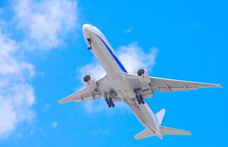 Passenger aircraft during taking off and nice blue sky in background photo
