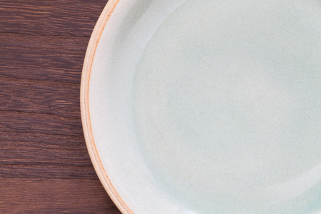 Celadon green ceramic on wood table background photo