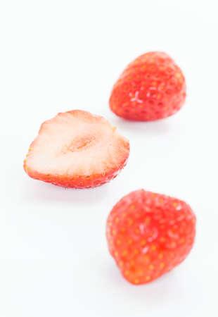 Fresh strawburry slice isolated on white background photo