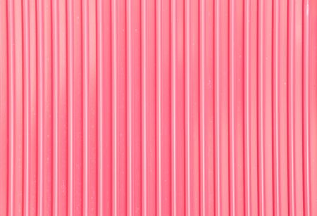 Pink corrugated metal background and texture surface photo