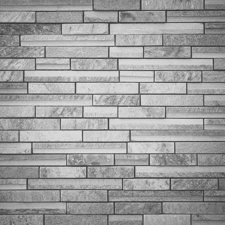 Texture and seamless background of white granite stone block wall photo
