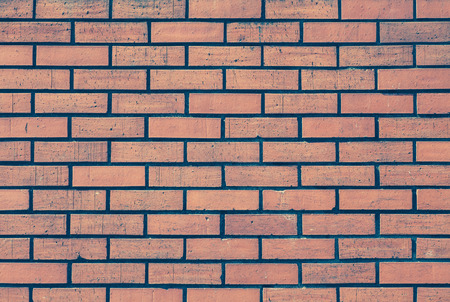 Red brick stone wall seamless background and texture photo