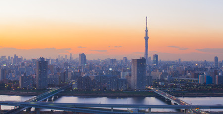 Tokyo city view with Tokyo sky tree and sumida river at twilight .