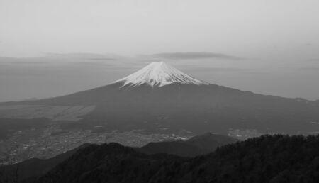 Mountain Fuji and Fujiyoshi town in spring season seen from Mountain Mitsutoge photo