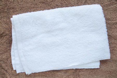 White clean towel on brown towel background Stockfoto