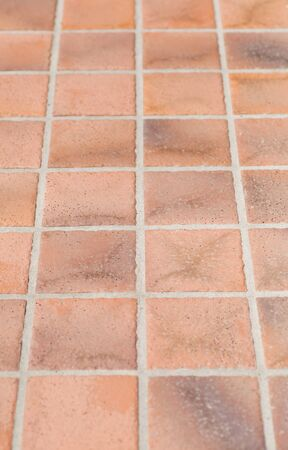 Brown earthenware floor tile seamless background and texture photo
