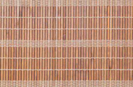 Brown bamboo mat pattern background seamless and texture photo