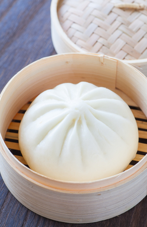 cuisines: Traditional chinese cuisines steamed bun in asian style bamboo basket
