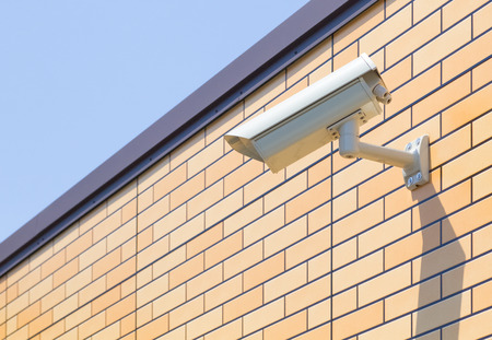 Video camera security system on the wall of the building photo