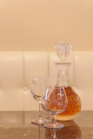 emty: Emty glass and bottle glass of whisky on wood table