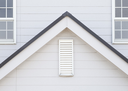 Detail of house exterior wall and window