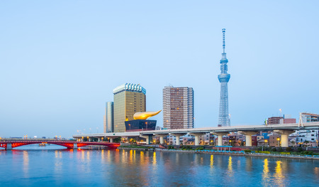 View of Tokyo Skytree landmark and Sumida river at night Stock Photo