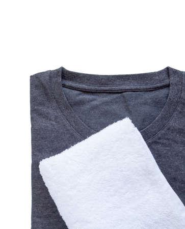 black t shirt: White towel and black t - shirt on white background Stock Photo