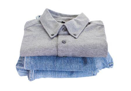 Grey cotton shirt and blue jean on white backgroun photo