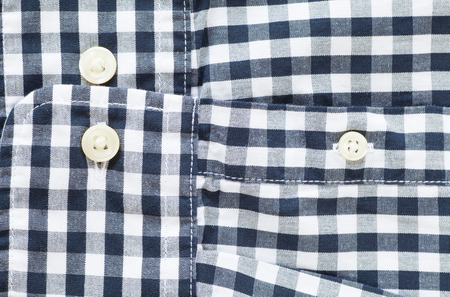 sleeve: Close - up Black and white check shirt sleeve and button