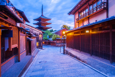 Japanese pagoda and old house in Kyoto at twilight Фото со стока