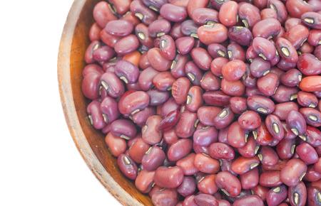 adzuki bean: Adzuki bean or red bean in wood bowl on white background