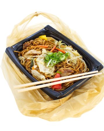 Japanese fried noodle yakisoba in plastic lunch box 写真素材