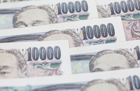 yen note: Stack of japanese currency yen or Japanese banknotes Stock Photo