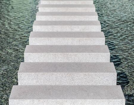 Modern concrete block pathway in water pool photo