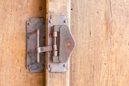 Close - up Old metal padlock and wood door photo