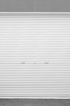White metal roller door shutter background and texture photo