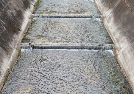 drainage: Concrete canal or drainage ditch in town Stock Photo