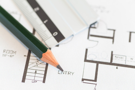 architect drawing: Architect rolls and plans construction project drawing