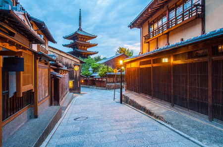 Japanese pagoda and old house in Kyoto at twilight Imagens