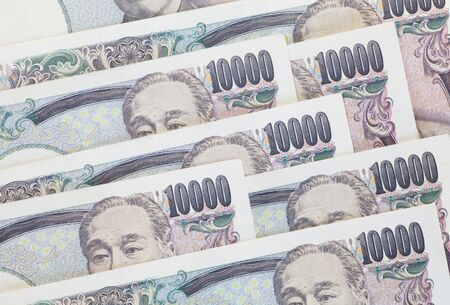 japan: Stack of japanese currency yen or Japanese banknotes Stock Photo