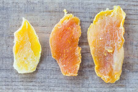 dehydrated: Piece of dehydrated mango on wood table background Stock Photo