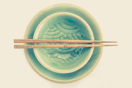 celadon green: Green celadon ceramic dish and wood chopstick