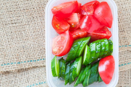 slice tomato: Slice cucumber  and slice tomato in plastic lunch box