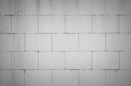 The modern white concrete tile wall background and texture stock