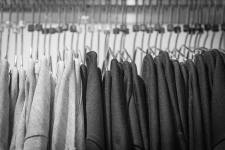 hangers: Black and white shirt on hangers in a retail shop Stock Photo