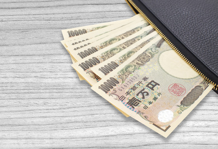 japanese currency: Stack of japanese currency yen or Japanese banknotes Stock Photo