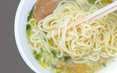 cooked instant noodle: Cooked Japanese instant cup noodle on wood table Stock Photo