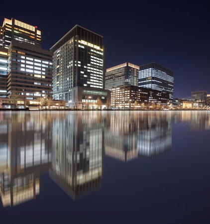 japanese people: View of Tokyo business building at night time Stock Photo