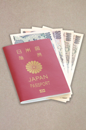 japanese currency: Japanese passport and Japanese currency yen inside