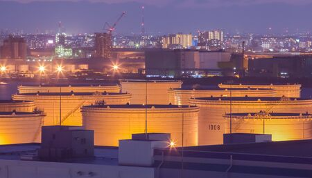 industrial industry: Oil tank at industrail zone and high building in the city in background