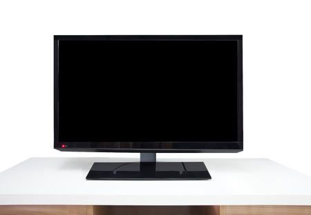 high definition television: Black digital televion and white table in room Stock Photo