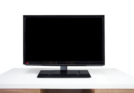 Black digital televion and white table in room Standard-Bild