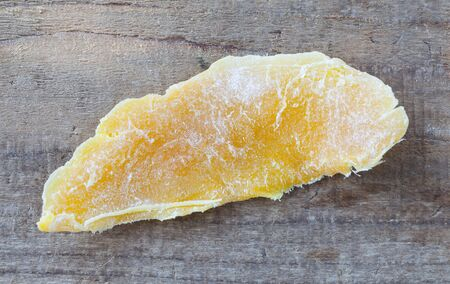 dehydrated: Piece of Dehydrated mango on wood table background