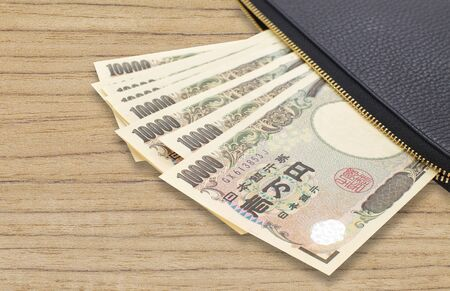 Stack of japanese currency yen or Japanese banknotes Stock Photo