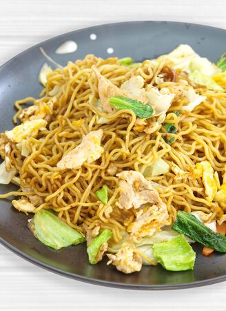 chinese menu: Chinese fried noodle with pork , egg and green vegetable