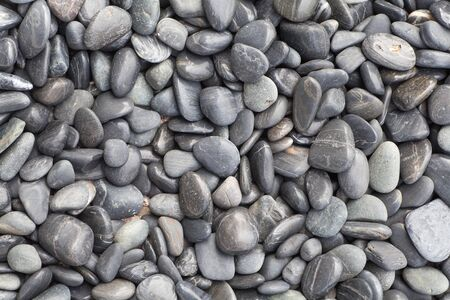 Small and smooth waterworn black pebble use for garden decoration