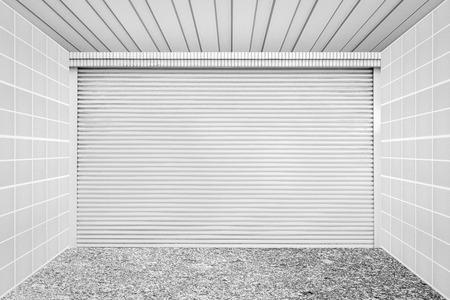 shutter door: White metal roll shutter door at home garage