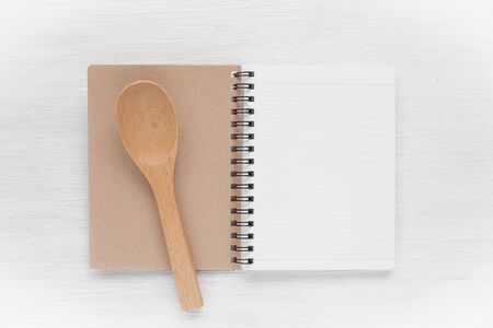Empty notebook and kitchen utensils for food recipes