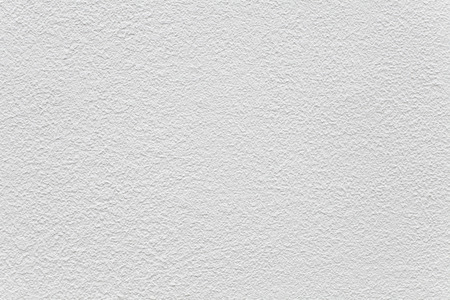 Wit cement muur geschilderd textuur en naadloze achtergrond